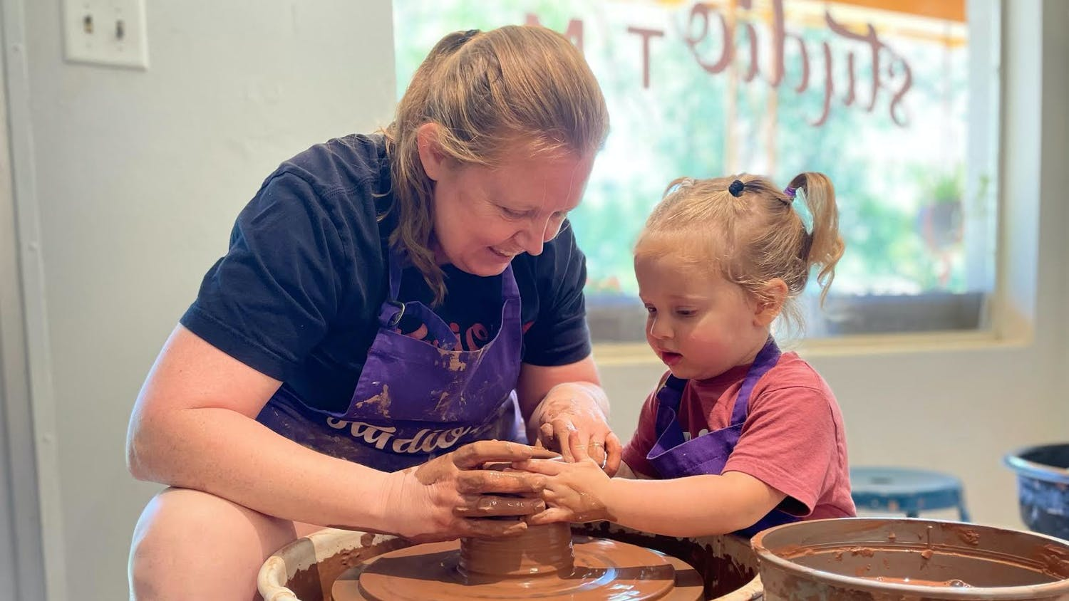 "Owners of Studio TM Ceramics Sara Truman and Naomi Mostkoff said their daughter Hazel started hanging out around the shop, where she ""likes getting her hands dirty,"" according to Mostkoff. (Courtesy to the Alligator)"