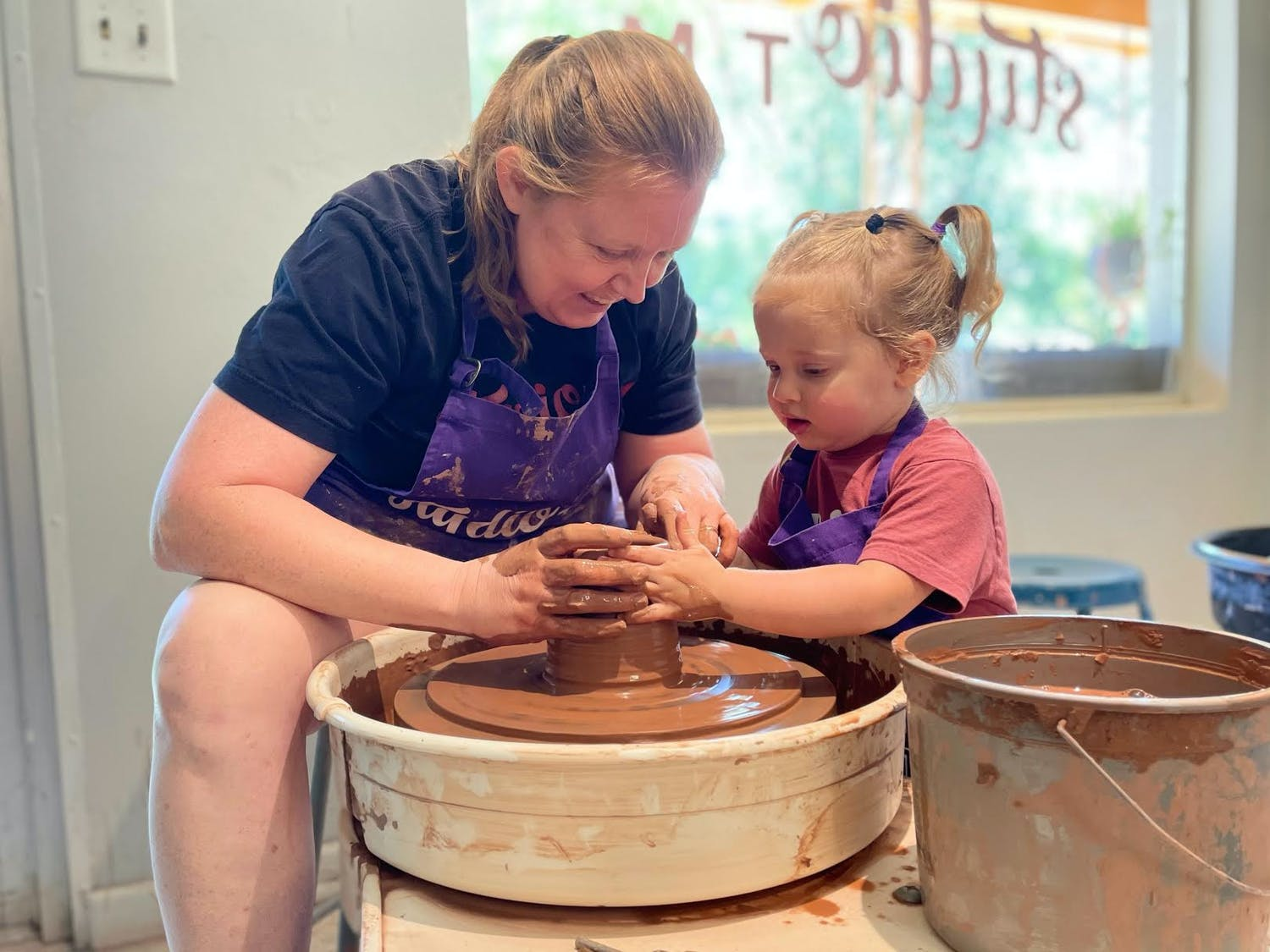 """Owners of Studio TM Ceramics Sara Truman and Naomi Mostkoff said their daughter Hazel started hanging out around the shop, where she """"likes getting her hands dirty,"""" according to Mostkoff. (Courtesy to the Alligator)"""