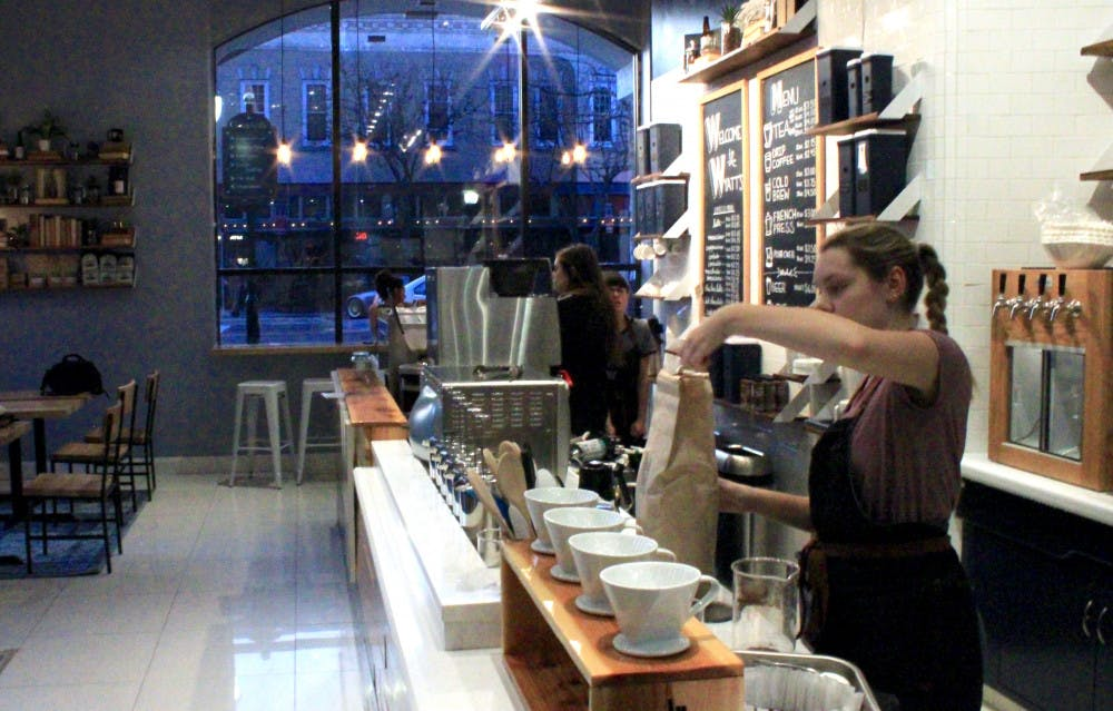 """<p dir=""""ltr""""><span>Emily Hart, a 20-year-old UF psychology student, scoops fresh coffee grounds from a bag on Sunday afternoon at Wyatt's Coffee's new downtown location at 202 SE Second Ave.</span></p><p><span></span></p>"""