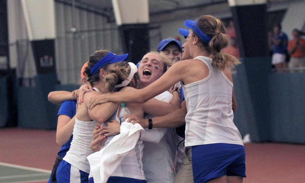 <p>Florida celebrates after its 4-2 win against Vanderbilt in the NCAA semifinals on Monday at the Lindsey Hopkins Indoor Courts in Athens, Georgia.</p>