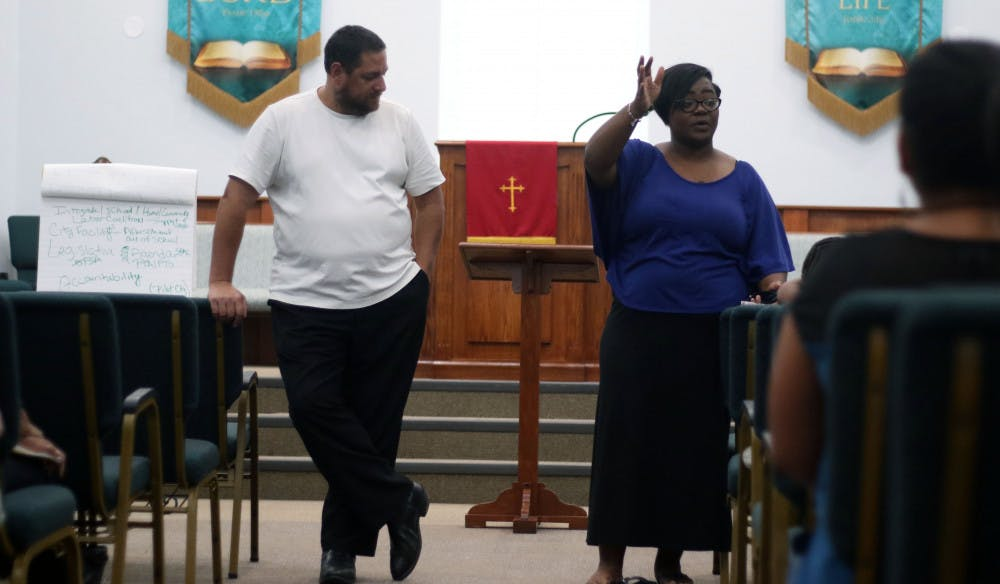 """<p dir=""""ltr""""><span>Larry Green, 48, and Chanae Jackson-Baker, 39, address the assembled attendants at a meeting to reform a recent racial equity plan by the Alachua County School Board on Monday night at DaySpring Missionary Baptist Church in Gainesville.</span></p><p><span></span></p>"""