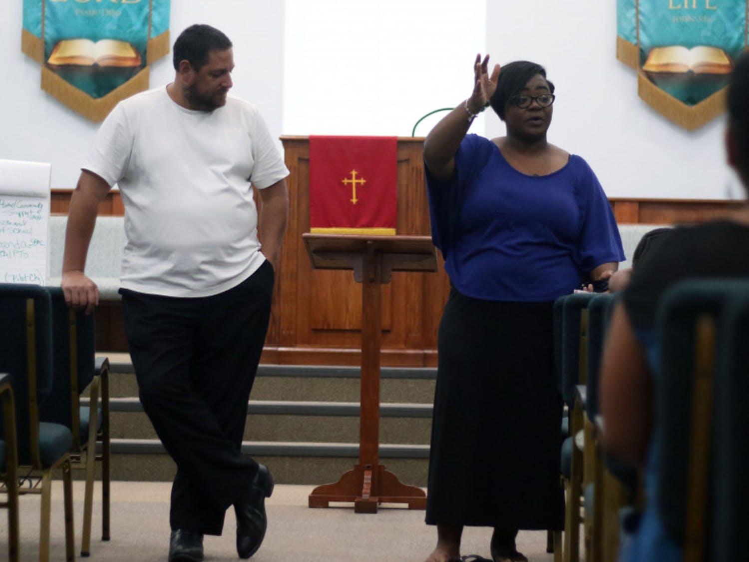 Larry Green, 48, and Chanae Jackson-Baker, 39, address the assembled attendants at a meeting to reform a recent racial equity plan by the Alachua County School Board on Monday night at DaySpring Missionary Baptist Church in Gainesville.