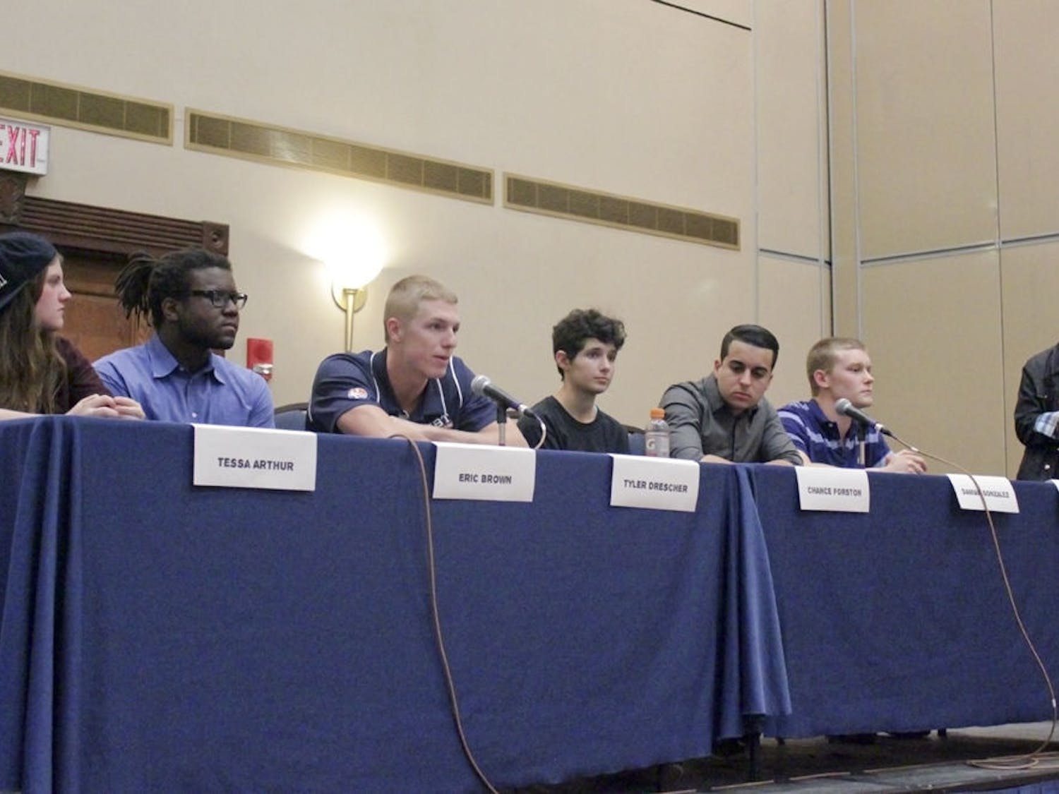From left, Tessa Arthur, Eric Brown, Tyler Drescher, Chance Forston, Damian Gonzales, Scott Strauss and LB Hannahs participate in Women's History Month's Masculine Mystique panel. The group discussed how concepts of masculinity have influenced their lives and gender expressions.