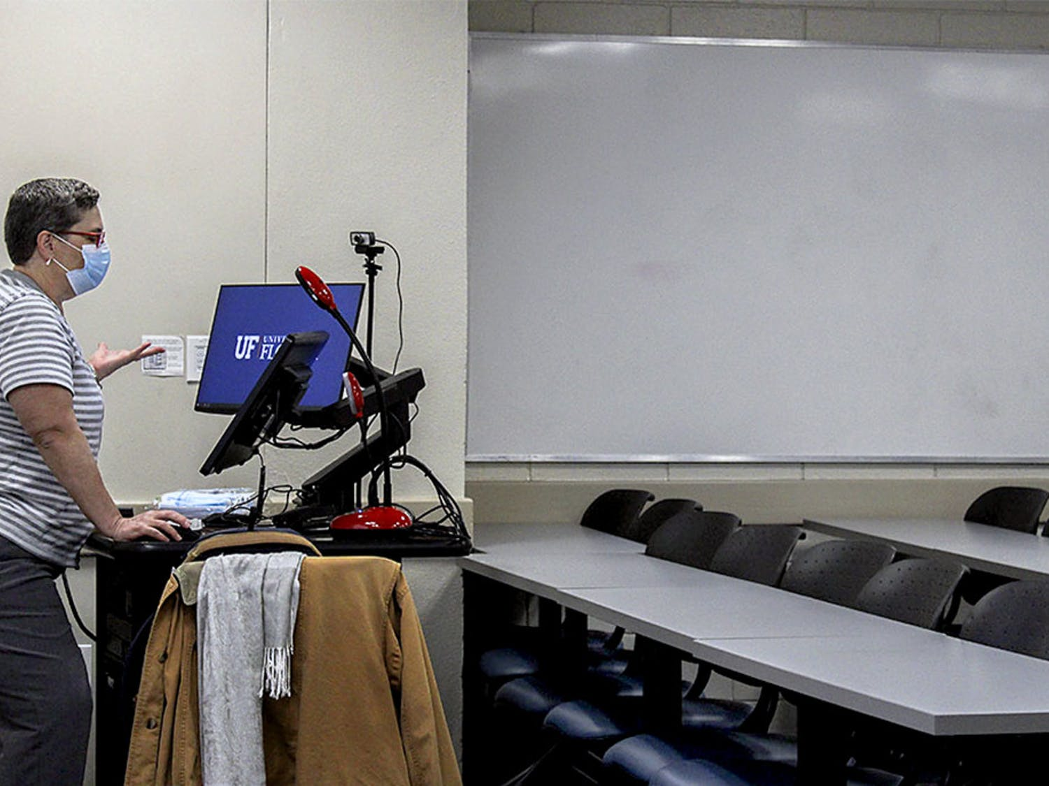 "Velvet Yates, director of distance learning for the UF Classics Department, begins class in an empty classroom on Wednesday, Jan. 13, 2021. She said the university requires her to teach in the classroom even if no students show up. ""It's absurd,"" Yates said. ""I've been teaching online classes for 15 years. I know how to teach online classes, and this isn't it."""