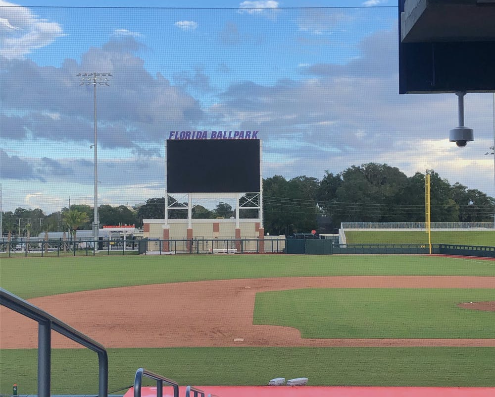 <p>A new scoreboard looms over the right-center gap, which coach Kevin O'Sullivan said measured 380 feet deep</p>