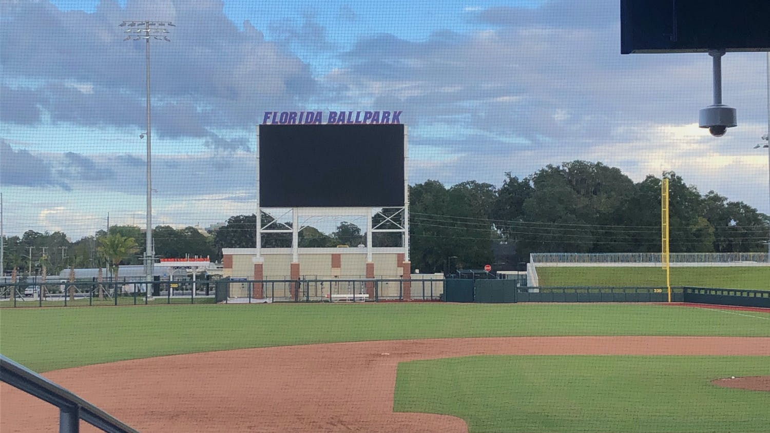 A new scoreboard looms over the right-center gap, which coach Kevin O'Sullivan said measured 380 feet deep
