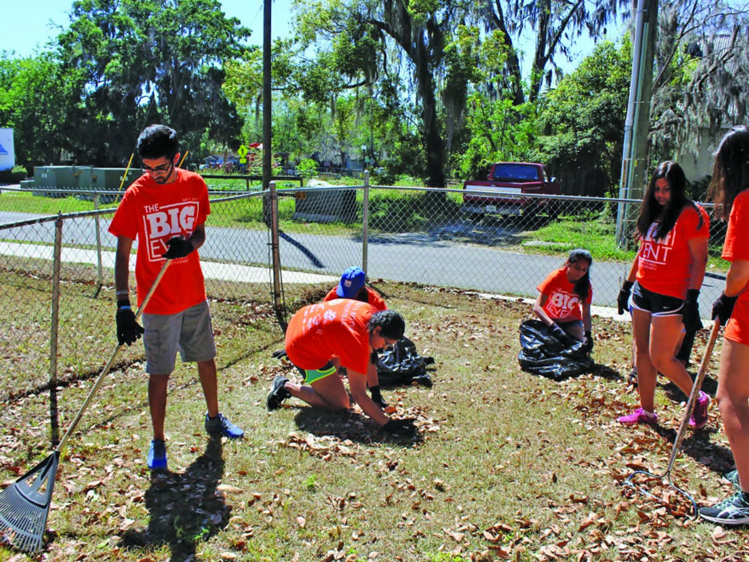 Amol Patadia, a 20-year-old UF biomedical engineering sophomore, rakes fallen leaves behind the home of a visually impaired woman in Gainesville's Porters Community on Saturday as a part of The Big Event, a daylong service event organized by UF Student Government. About 760 students participated at about 45 locations across Gainesville.