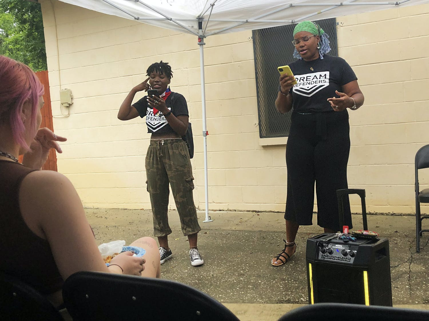 """Alexandra St Tellien, (left) one of the speakers brings Kiara Laurent (right) onstage to recite a poem to the crowd at the """"We Keep Us Safe"""" event on Saturday, June 26, 2021."""