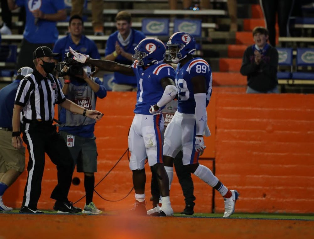 <p>Kadarius Toney (1) and receiver Justin Shorter (89) celebrate a score in Saturday's win against Missouri.</p>