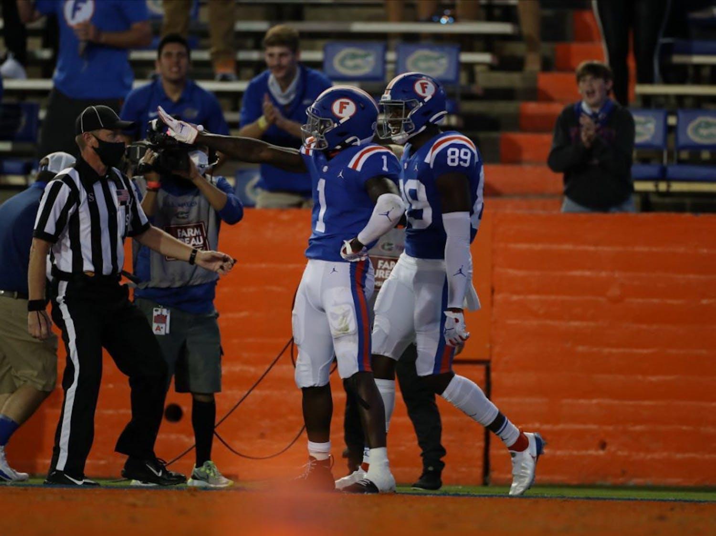 Kadarius Toney (1) and receiver Justin Shorter (89) celebrate a score in Saturday's win against Missouri.