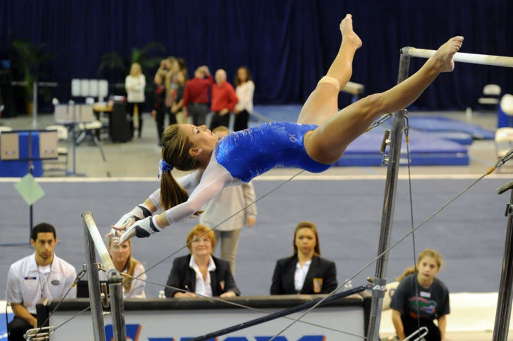 <p>Mackenzie Caquatto performs on the uneven bars during Florida's 198.05-196.70 win over Georgia on Jan. 24.&nbsp;</p>