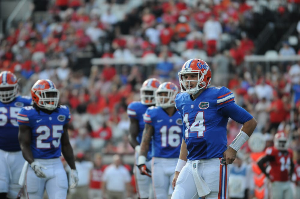 <p>Luke Del Rio looks to the sideline for instruction during Florida's 24-10 win over Georgia on Oct. 29, 2016, in Jacksonville.</p>