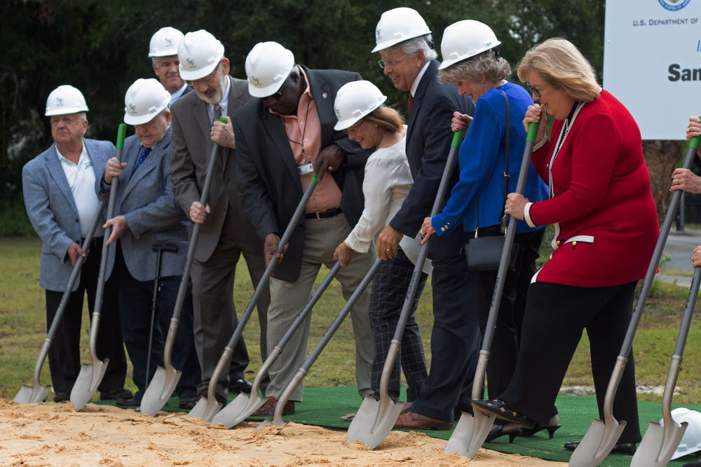 """<p><span id=""""docs-internal-guid-c164c3cd-7fff-d7ed-b56a-970f9b9d8df5""""><span>The Blount Center Board of Directors break ground at the new Blount Campus building at Santa Fe College Wednesday morning. Once completed, the building will act as a hub for """"business innovation"""" and will include classrooms, labs and other student support and service areas.</span></span></p><p><span id=""""docs-internal-guid-c164c3cd-7fff-d7ed-b56a-970f9b9d8df5""""><span>""""Without this great city, this campus would have never been here,"""" said Santa Fe College president Dr. Jackson N. Sasser during the ceremony.</span></span></p>"""
