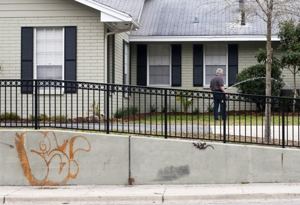 <p>Graffiti covers the wall in front of a house on University Avenue on Thursday. In response to increased amounts of graffiti, spokesman Bob Woods said the city has developed a campaign to raise public awareness toward the issue and minimize the unwelcome marks. The campaign will be unrolled this month.</p>