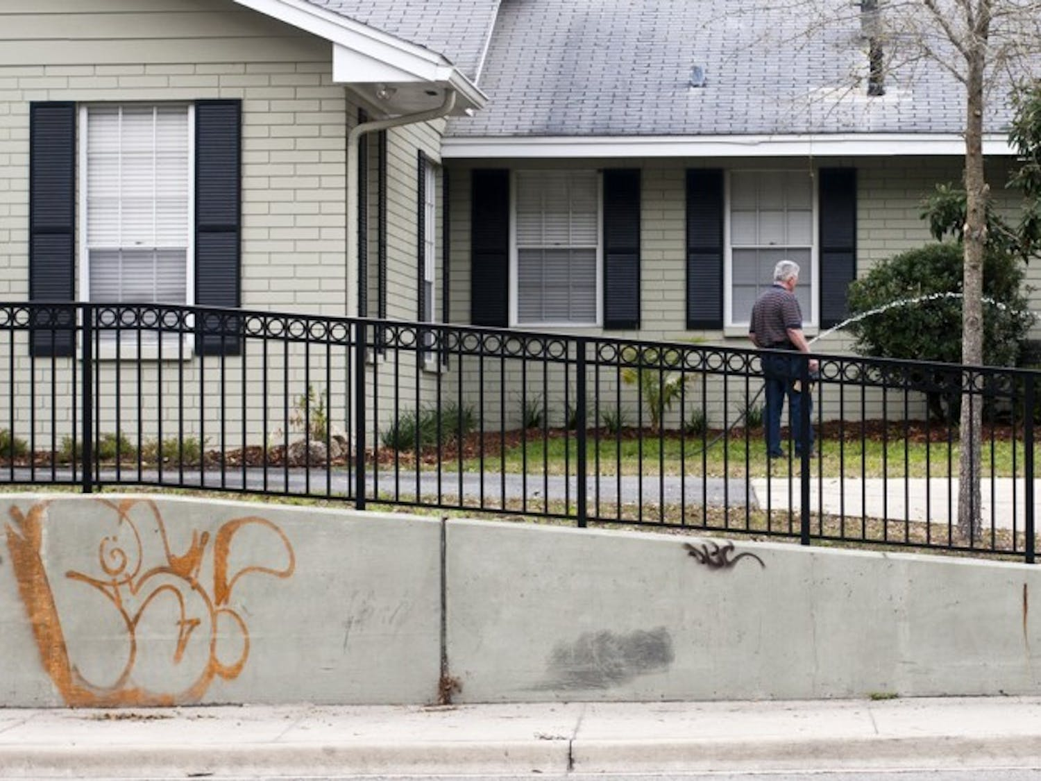 Graffiti covers the wall in front of a house on University Avenue on Thursday. In response to increased amounts of graffiti, spokesman Bob Woods said the city has developed a campaign to raise public awareness toward the issue and minimize the unwelcome marks. The campaign will be unrolled this month.