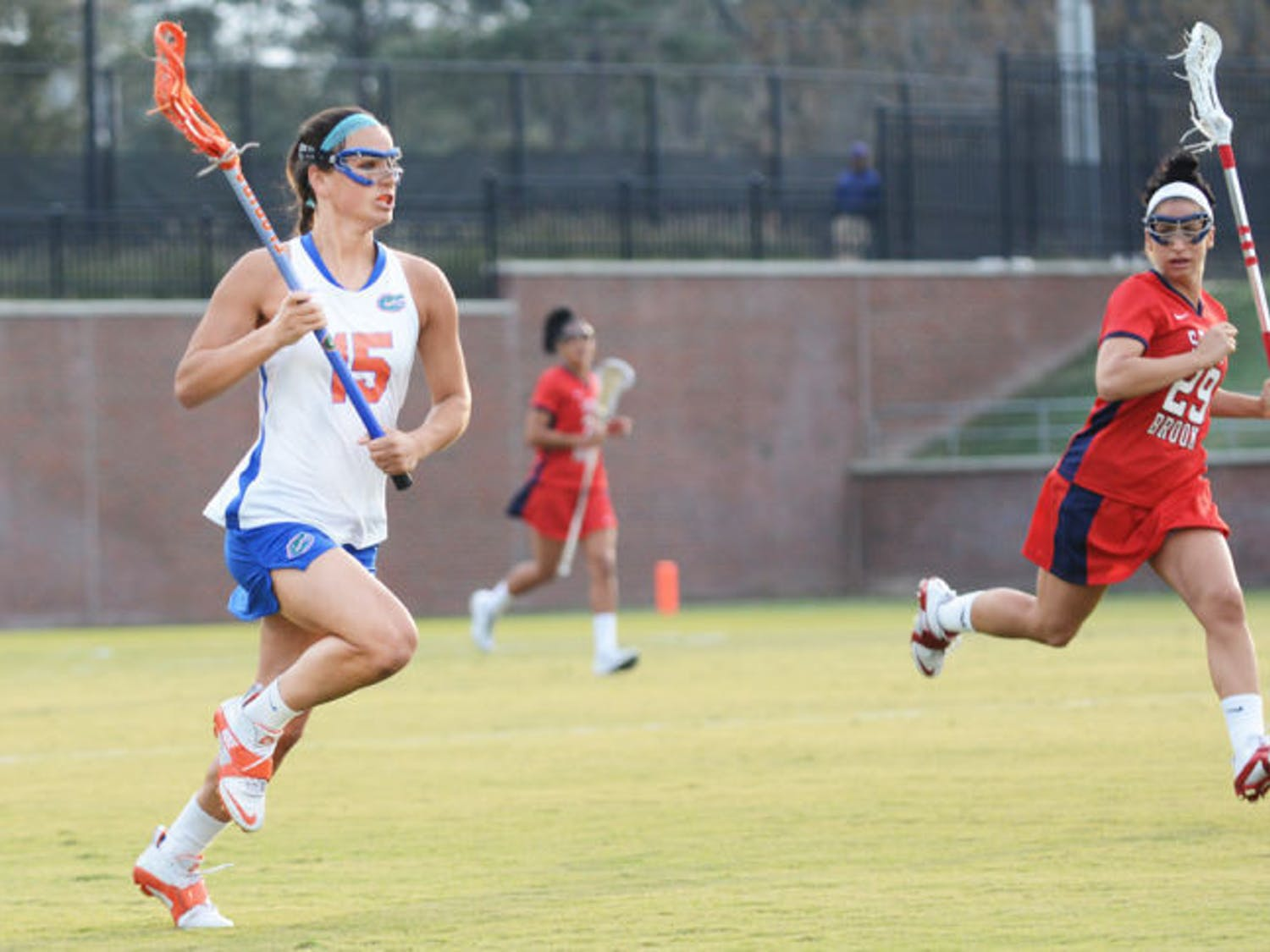 Senior Sam Farrell runs down the field during Florida's 16-9 win against Stony Brook on Feb. 20 at Dizney Stadium. UF will clinch the American Lacrosse Conference championship outright win a win against Northwestern on Saturday and a Penn State loss.