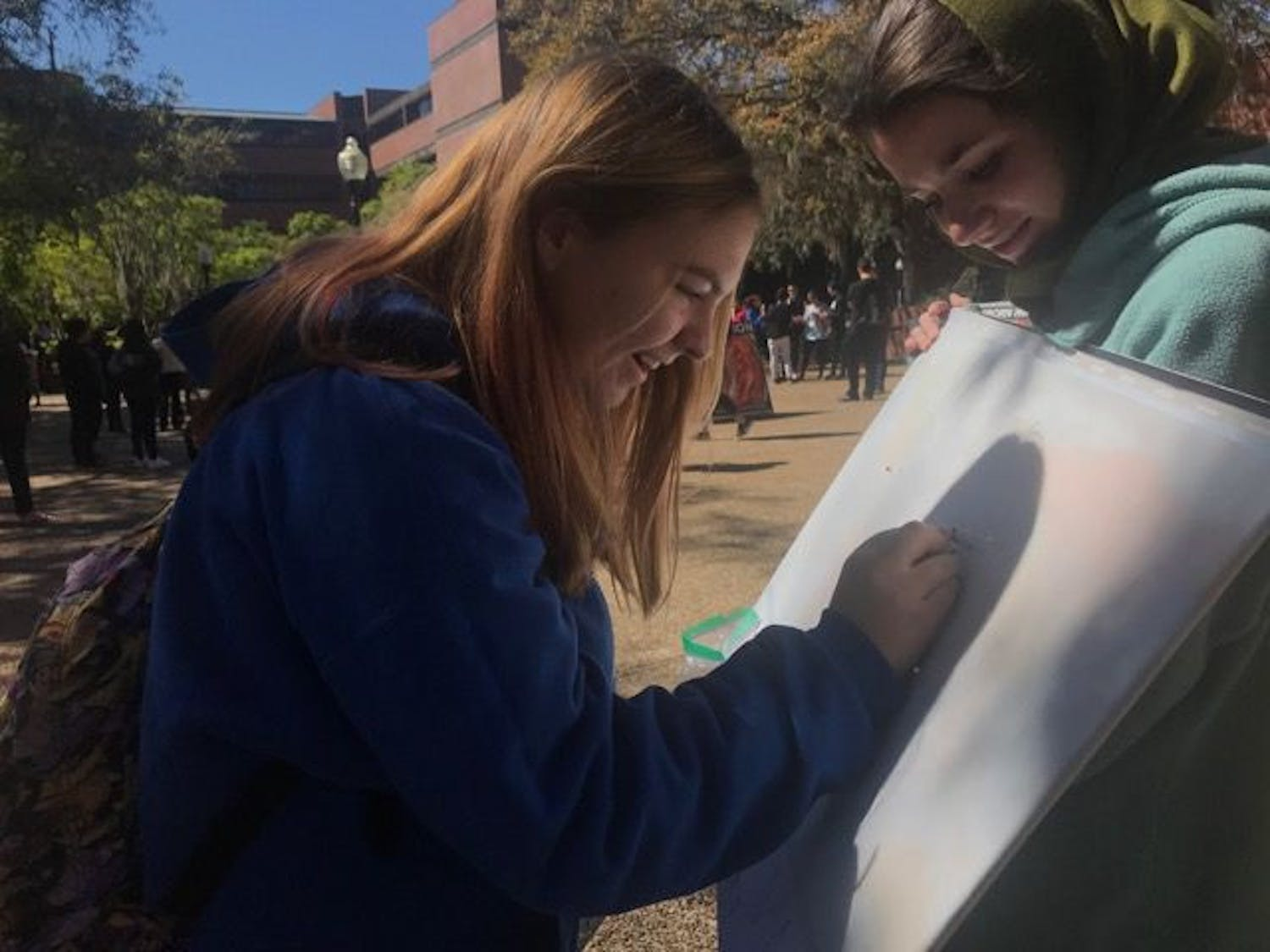 Kaitlin Thorp, an 18-year-old UF wildlife ecology and conservation freshman, stopped by Turlington Plaza on Wednesday morning to participate in Pin Syria on a Map, an event put on by Students Organize for Syria.