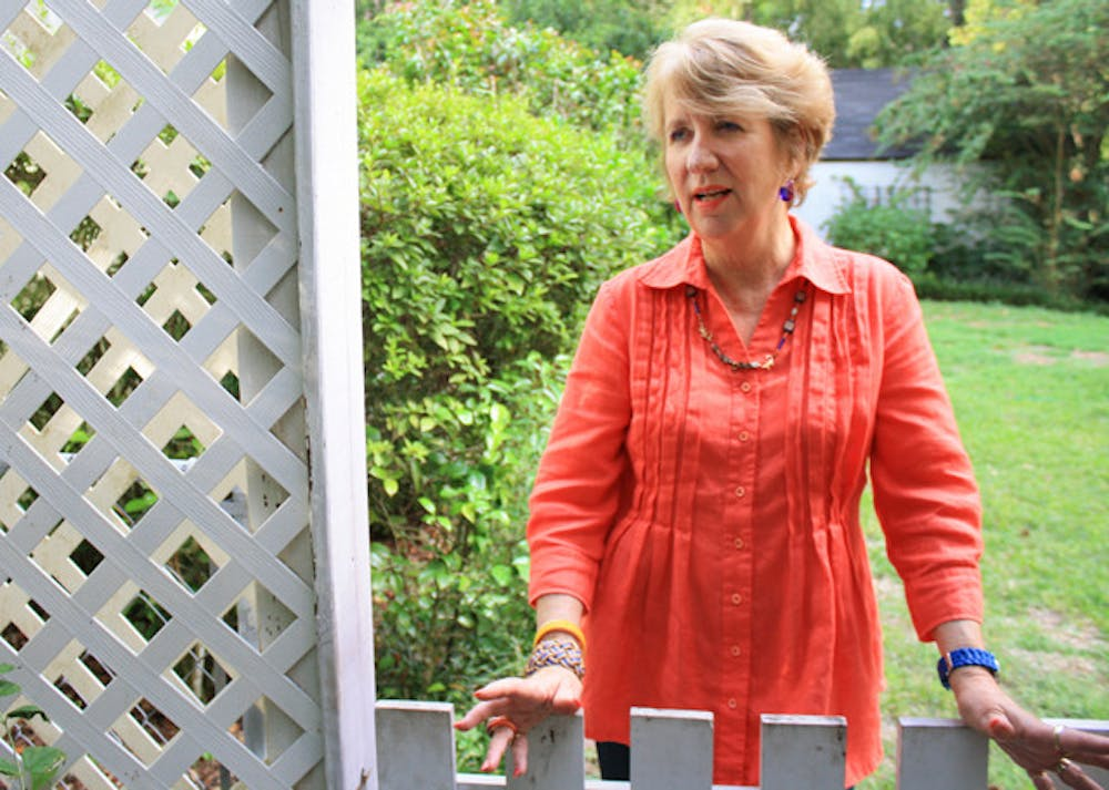 <p>Donna Lutz, 66, stands outside her home Friday. She is running for the Gainesville City Commission at-large 1 seat.</p>