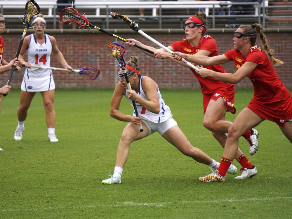 <p>Shayna Pirreca (center) dodges defenders during Florida's 14-4 loss to Maryland on March 19, 2016, at Donald R. Dizney Stadium.</p>