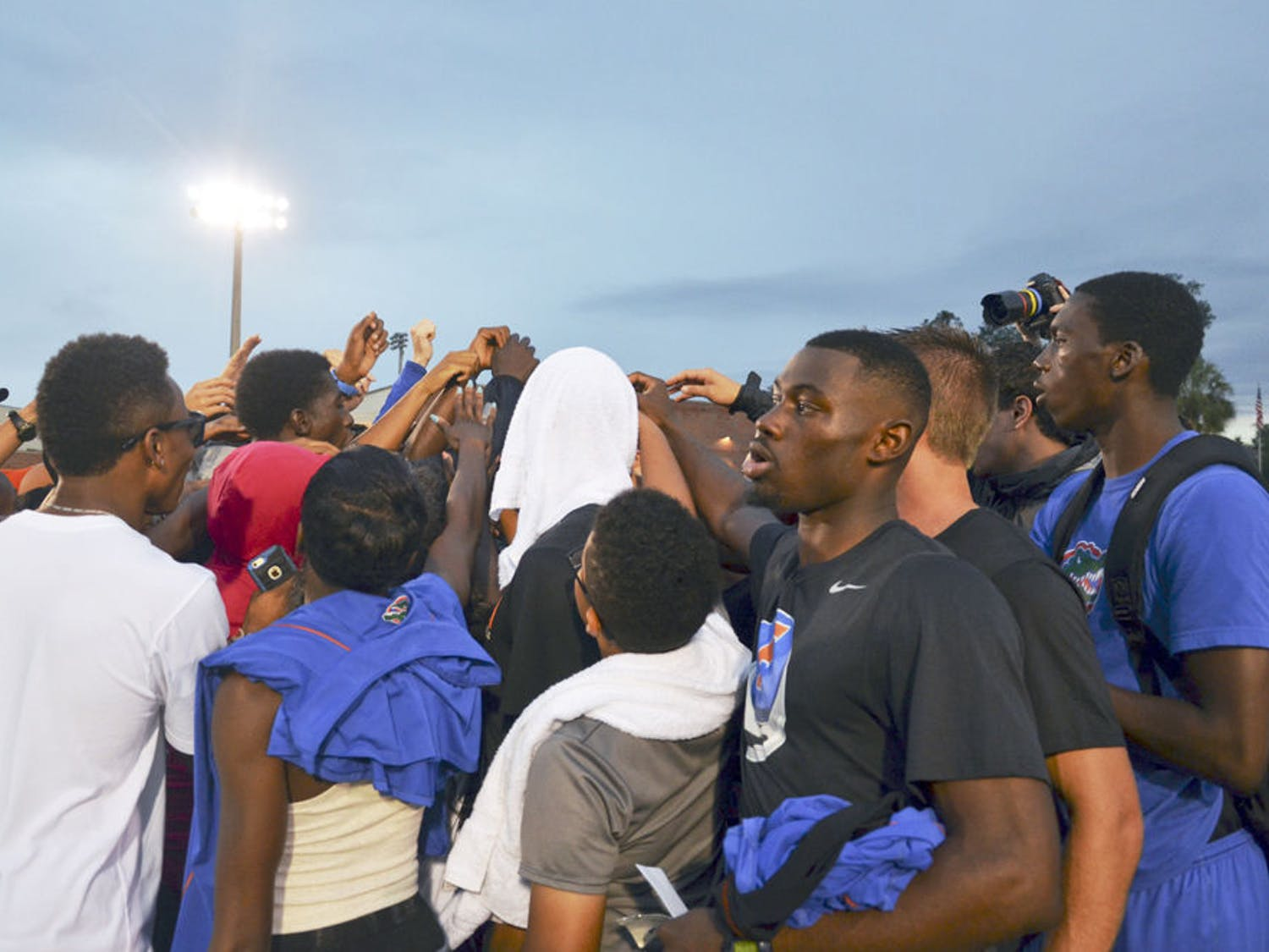 The Florida track and field team huddles together following the conclusion of the 2015 Florida Relays on Saturday at the Percy Beard Track.
