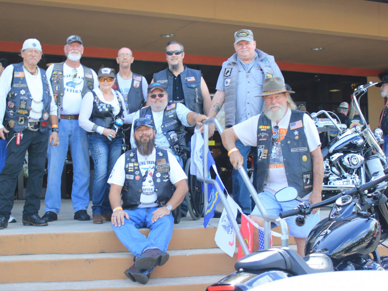 Members of Rolling Thunder pose for a group photograph outside of the Gainesville Harley-Davidson dealership.