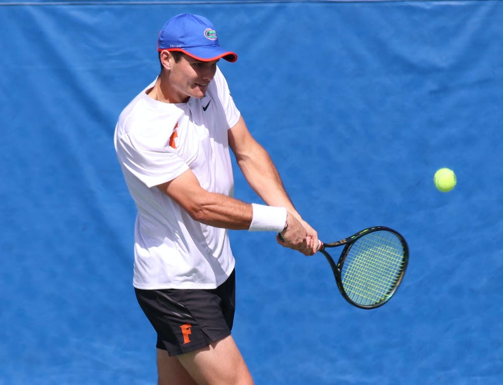 Although he missed the doubles competition, Sam Riffice warmed up for his singles bout and refused to give up a single game. Photo from UF-Auburn match Feb. 21.