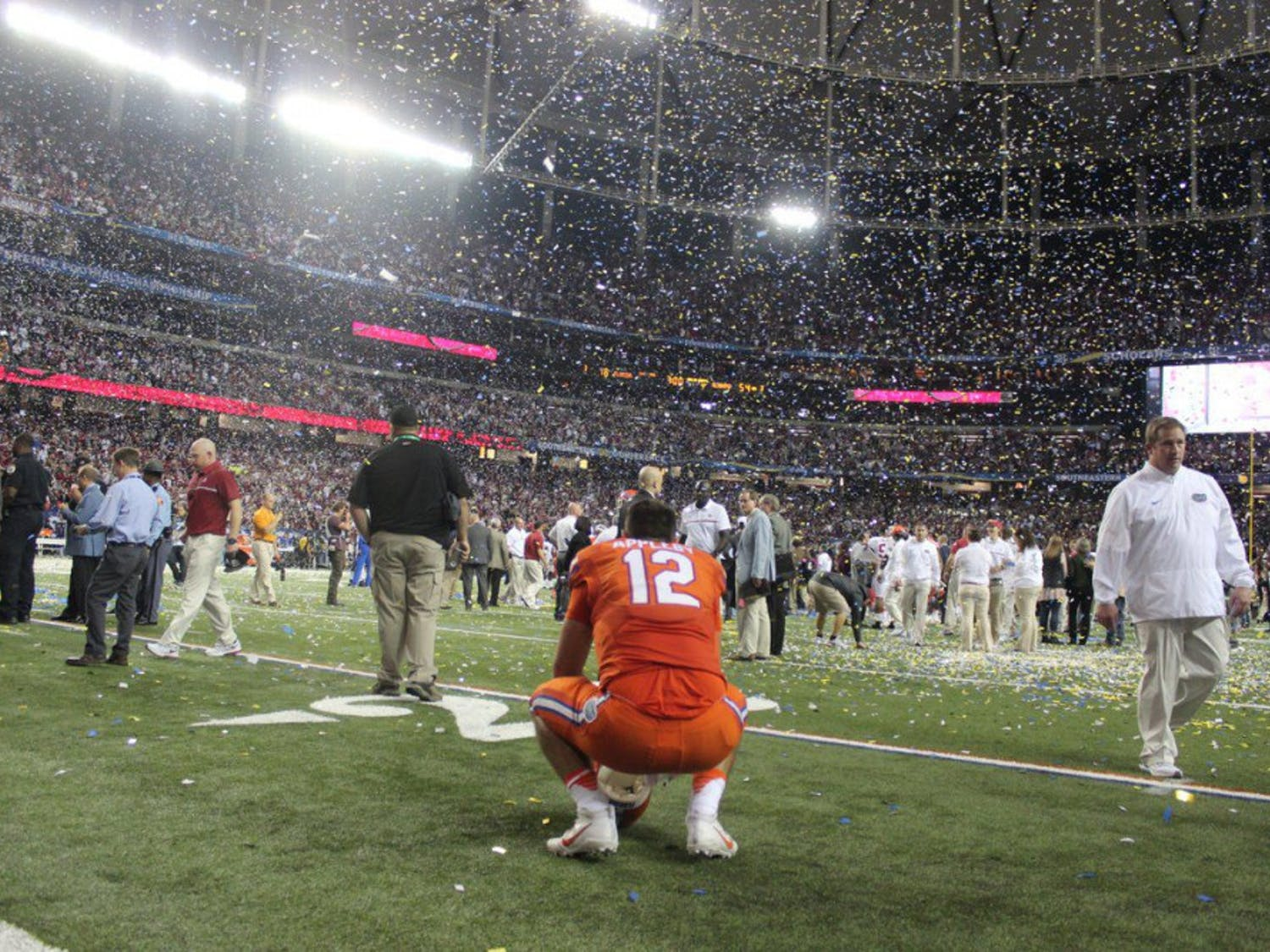 Austin Appleby kneels on the field after Florida's 54-16 loss to Alabama on Dec. 3, 2016, in the SEC Championship Game.