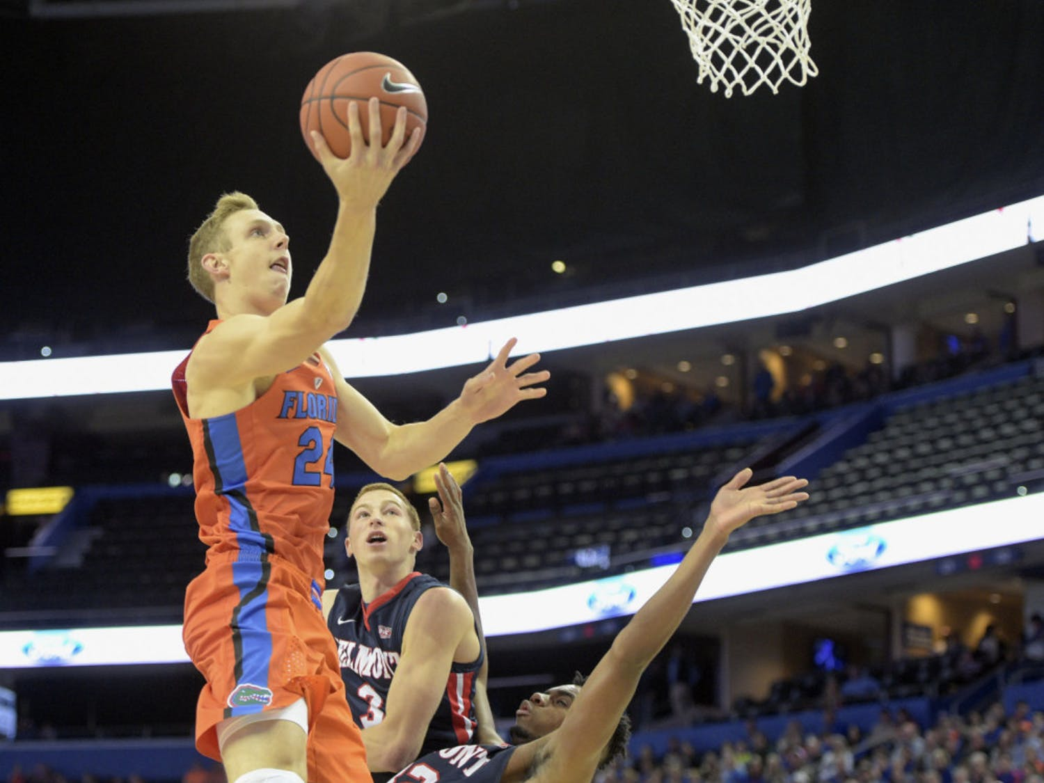 Florida guard Canyon Barry (24) drives to the basket over Belmont forward Amanze Egekeze (32) and guard Dylan Windler (3) in the first half of an NCAA college basketball game in Tampa, Fla., on Monday, Nov/ 21, 2016. (Andres Leiva/Tampa Bay Times via AP)