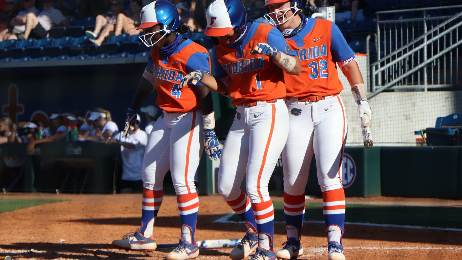 Hannah Adams, Charla Echols and Kendyl Lindaman celebrate at home plate in Florida's 4-0 win over Texas A&M on May 8. The Gators begin their run in the SEC Tournament Thursday.