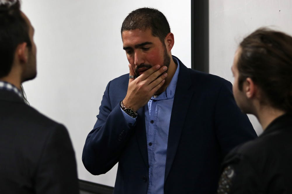"""<p dir=""""ltr"""">Yoni Michanie, activist and Sgt. 1st Class in the Israeli Defense Force, talks with students Tuesday night after speaking in Little Hall.</p>"""