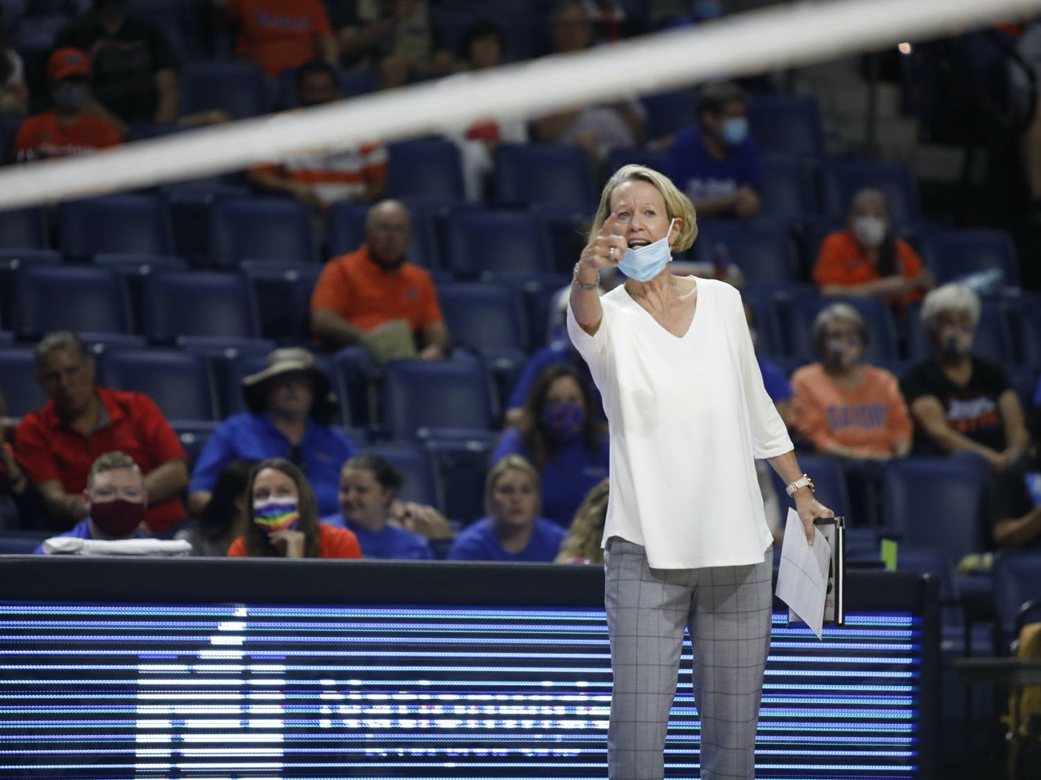 Florida head coach Mary Wise communicates with her players during a game against Mississippi State on Sept. 24.
