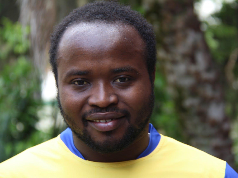 Valens Nteziyaremye, 26, poses for a photo.