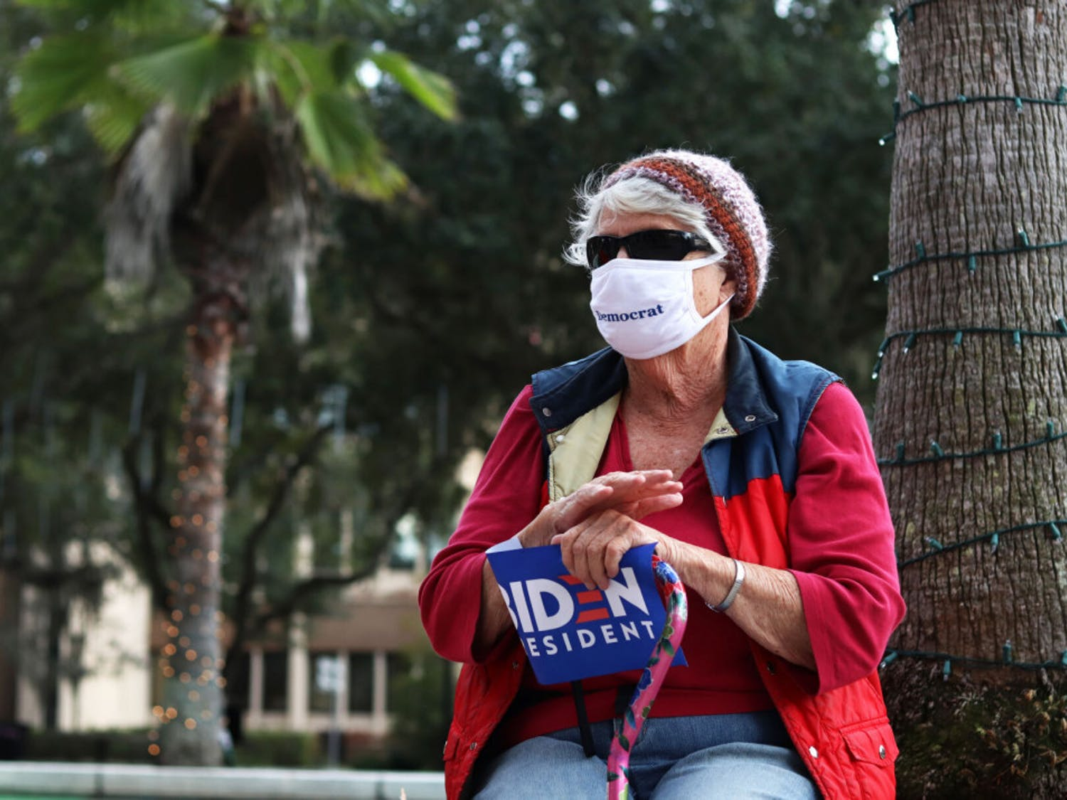 """Nancy Parkinson claps during the """"Protect the Results"""" rally hosted by the Blue Wave Coalition of Alachua County at the Alachua City Hall on Wednesday, Nov. 4, 2020. (Lauren Witte/Alligator Staff)"""