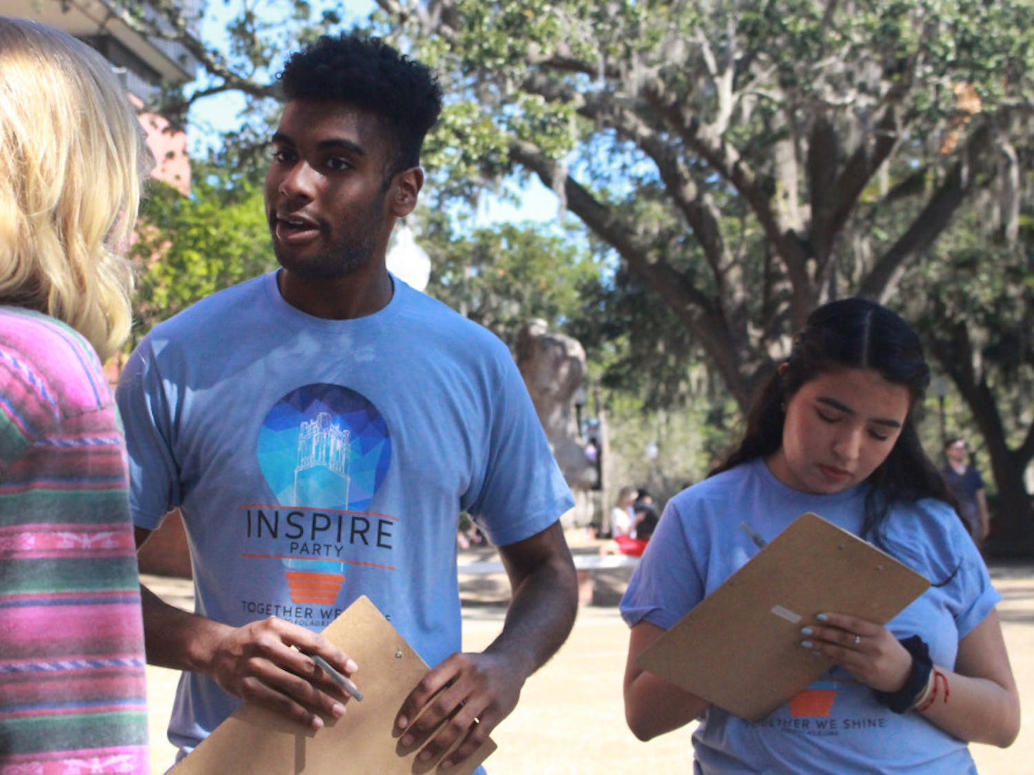 Che John, a 19-year-old UF finance sophomore, and Maria Espinoza, a 19-year-old UF criminology sophomore, talked to students Tuesday afternoon on Turlington Plaza. John and Espinoza are both members of Inspire Party, and they spent the afternoon reaching out to students about the upcoming Student Government elections.