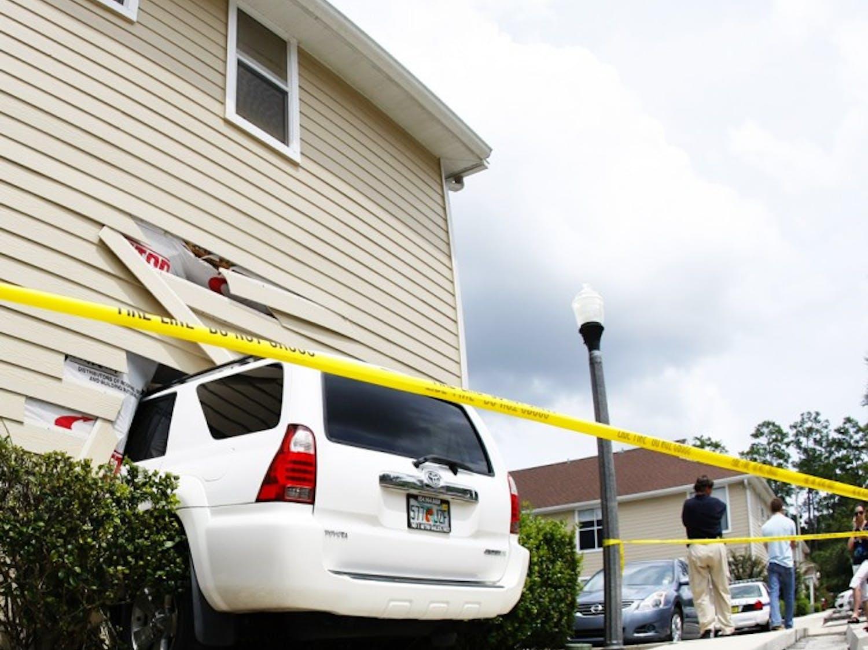 Mercedes Machado, a first-year mental health counseling graduate student, drove her car halfway into her neighbor's condominium, Kensington South Condos apartment No. 801.