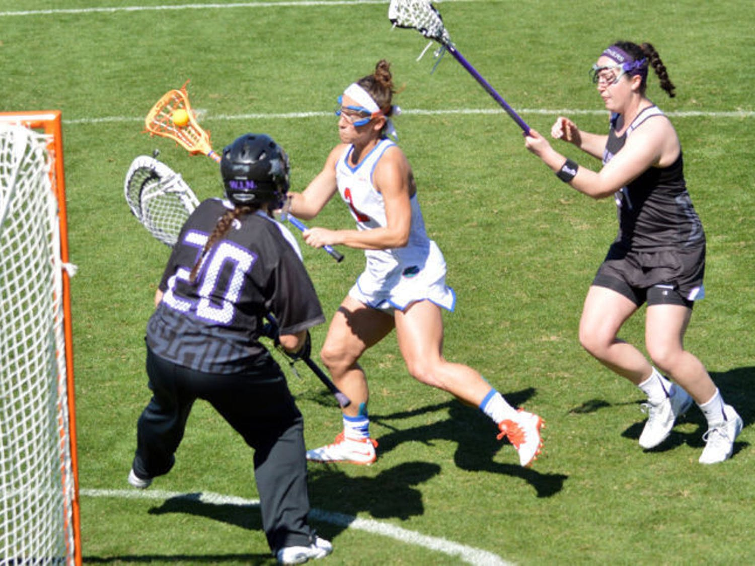 Sammi Burgess attempts a shot during Florida's 18-7 win against High Point on Feb. 15 at Donald R. Dizney Stadium. Burgess, the ALC Rookie of the Week, scored a career-high four goals against Vanderbilt on Sunday.