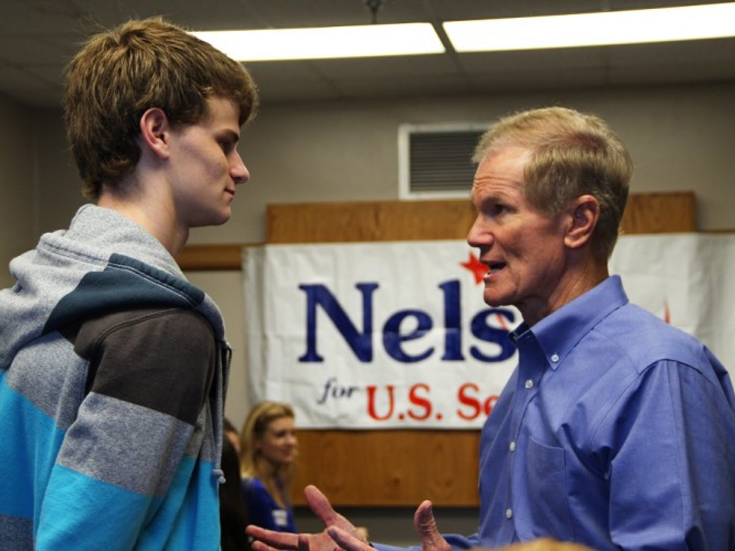 Sen. Bill Nelson greets Kenny Heidegger, an 18-year-old political science freshman. Nelson held a discussion and a Q-and-A session at which students asked questions pertaining to the environment and how to urge the average voter away from bipartisanship.