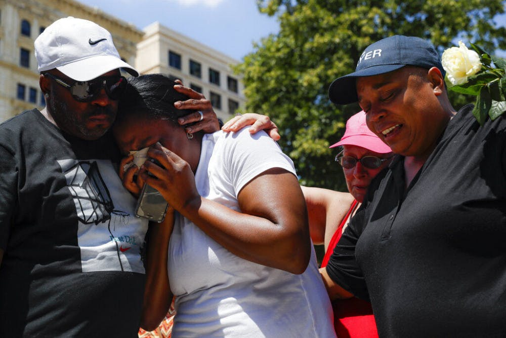 <p>Mourners gather at a vigil following a nearby mass shooting, Sunday, Aug. 4, 2019, in Dayton, Ohio. Multiple people in Ohio have been killed in the second mass shooting in the U.S. in less than 24 hours, and the suspected shooter is also deceased, police said.&nbsp;</p>
