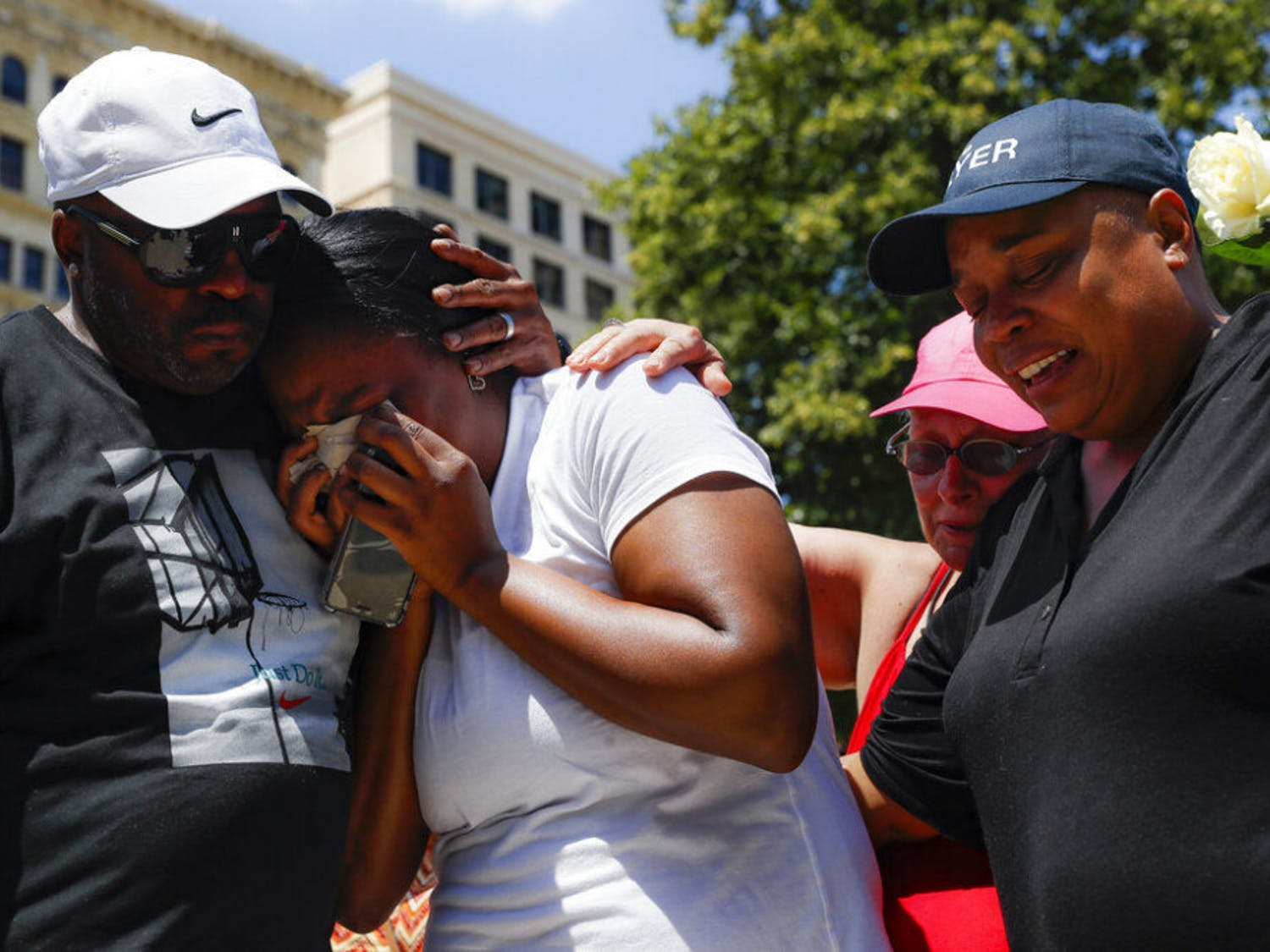 Mourners gather at a vigil following a nearby mass shooting, Sunday, Aug. 4, 2019, in Dayton, Ohio. Multiple people in Ohio have been killed in the second mass shooting in the U.S. in less than 24 hours, and the suspected shooter is also deceased, police said.
