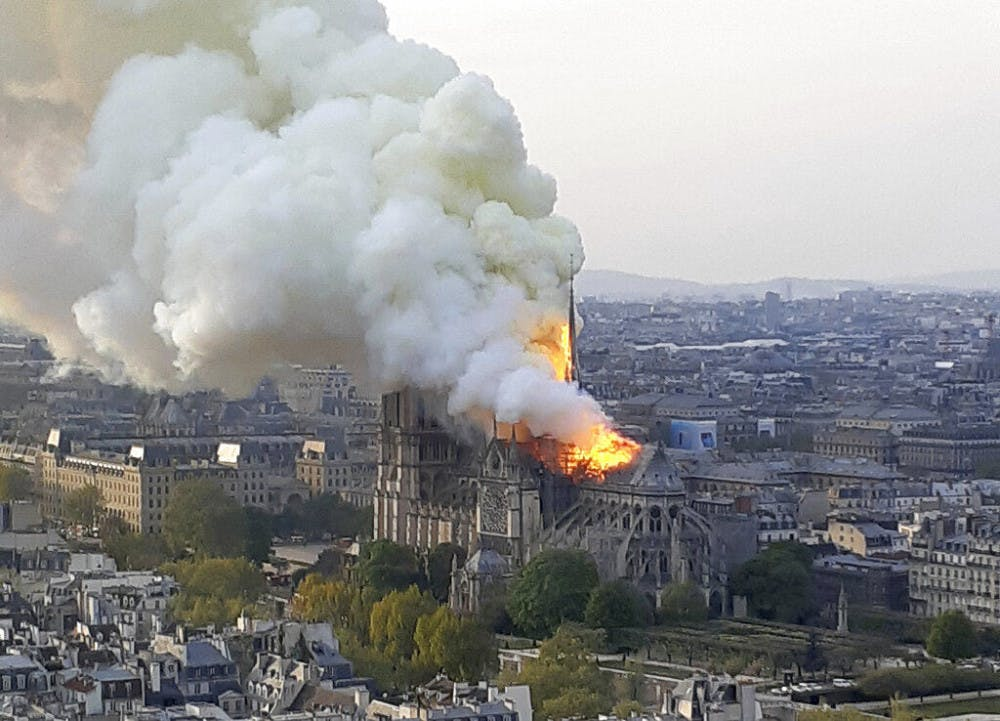 """<p>In this image made available on Tuesday April 16, 2019 flames and smoke rise from the blaze at Notre Dame cathedral in Paris, Monday, April 15, 2019. An inferno that raged through Notre Dame Cathedral for more than 12 hours destroyed its spire and its roof but spared its twin medieval bell towers, and a frantic rescue effort saved the monument's """"most precious treasures,"""" including the Crown of Thorns purportedly worn by Jesus, officials said Tuesday. (AP Photo/Cedric Herpson)</p>"""