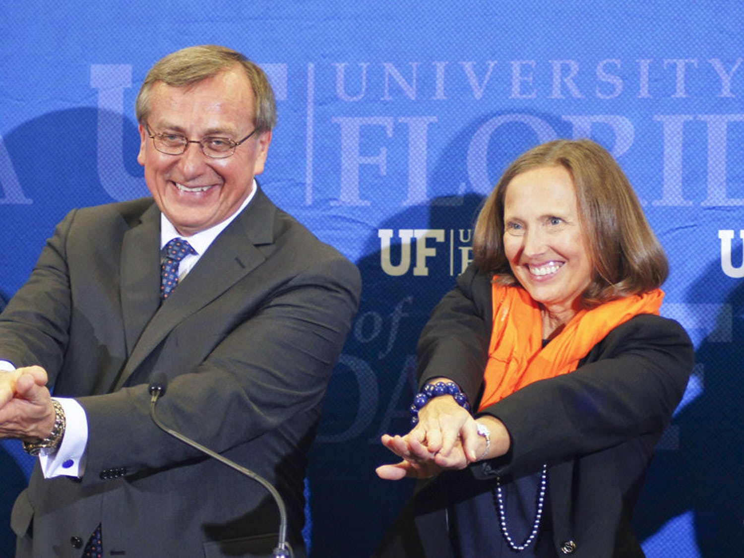 Kent Fuchs and his wife, Linda, Gator Chomp after the Cornell University provost was named UF's 12th president at Emerson Alumni Hall on Wednesday.