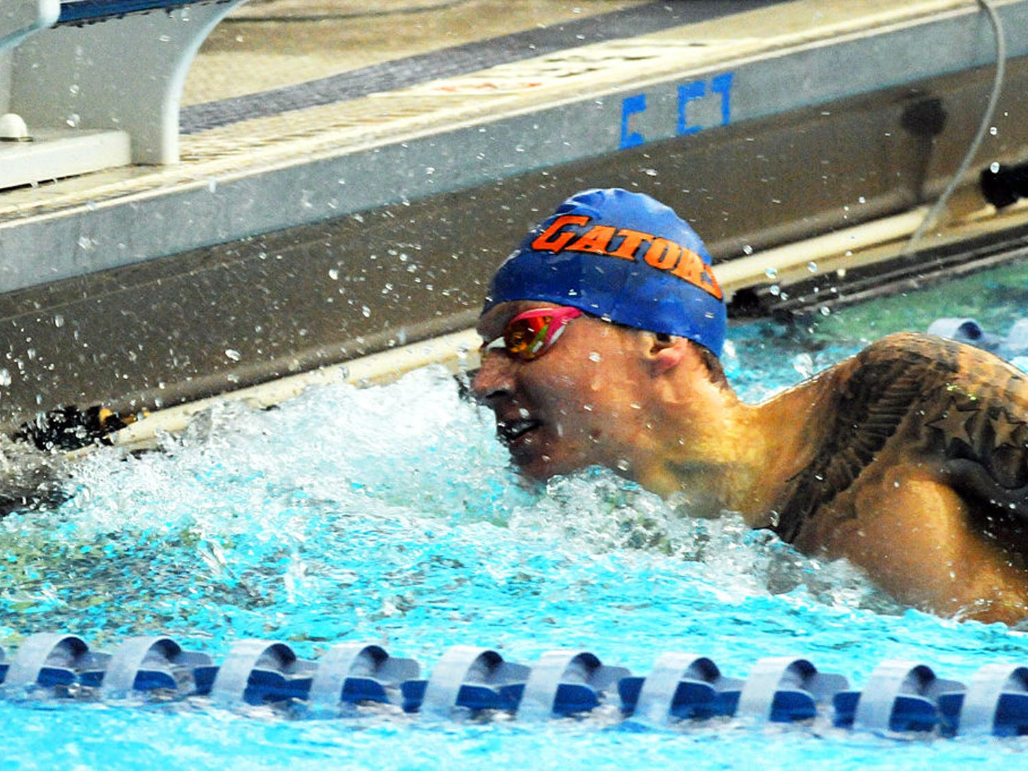 Caeleb Dressel touches the wall at the end of his leg of the 400 meter freestyle relay during Florida's meet against Auburn on Jan. 23, 2016, in the O'Connell Center.