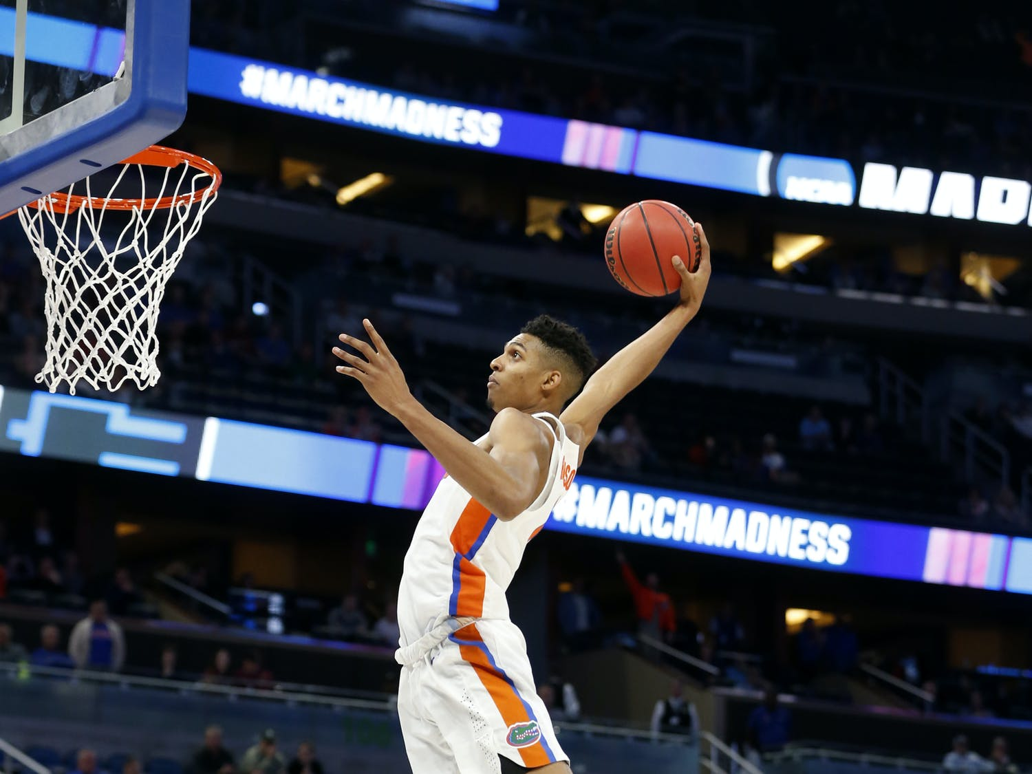 Florida forward Devin Robinson dunks the ball during the second half of the first round of the NCAA college basketball tournament against East Tennessee State, Thursday, March 16, 2017 in Orlando, Fla. Florida defeated ETSU 80-65. (AP Photo/Wilfredo Lee)