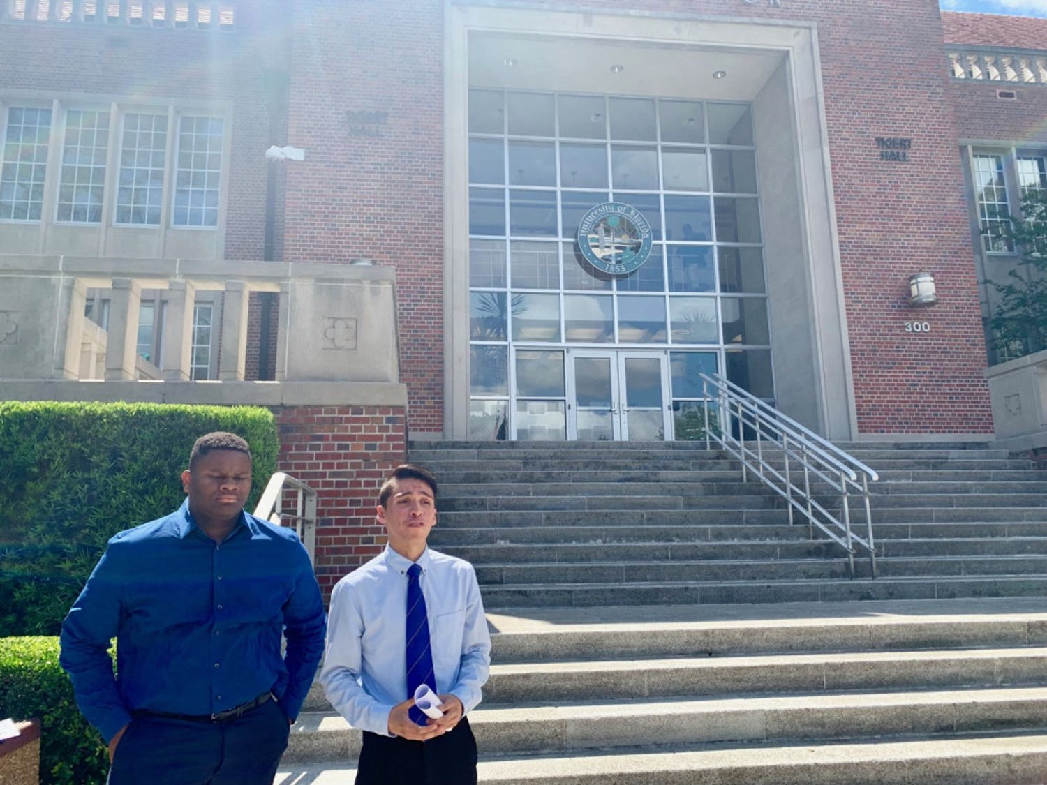 Anthony Rojas, a 23-year-old UF political science master's student, and Mackintosh Joachim, president of the UF chapter of the NAACP, announced a boycott of the university-wide commencement ceremony on Friday afternoon outside Tigert Hall.