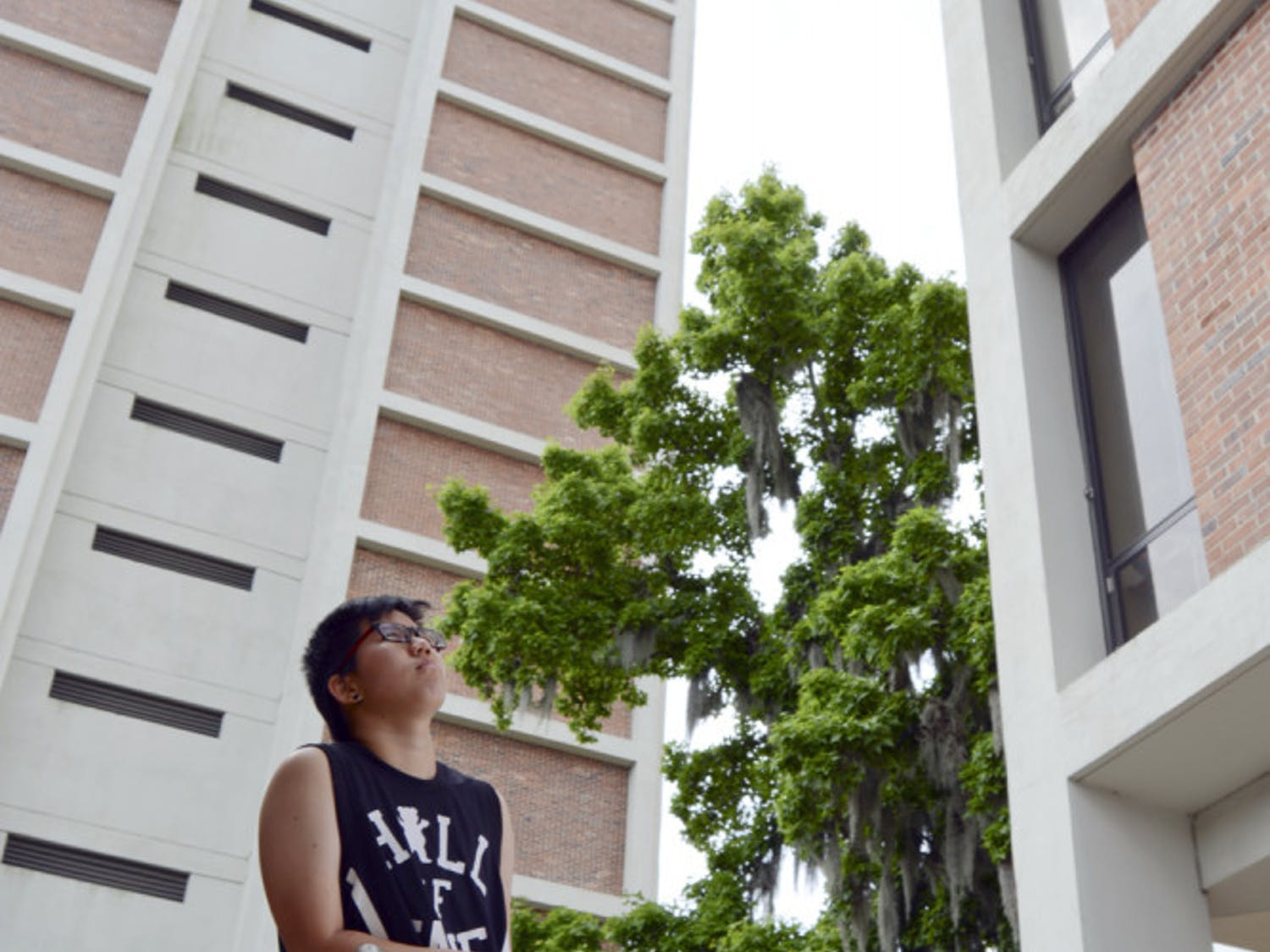 May Niu, a 21-year-old UF industrial and systems engineering junior, poses for a photo in between the Beaty Towers on Sunday. A member of the pilot class of the Innovation Academy, Niu was not able to run for president of the Chinese American Student Association last fall because she would not be enrolled as a full-time student until spring.