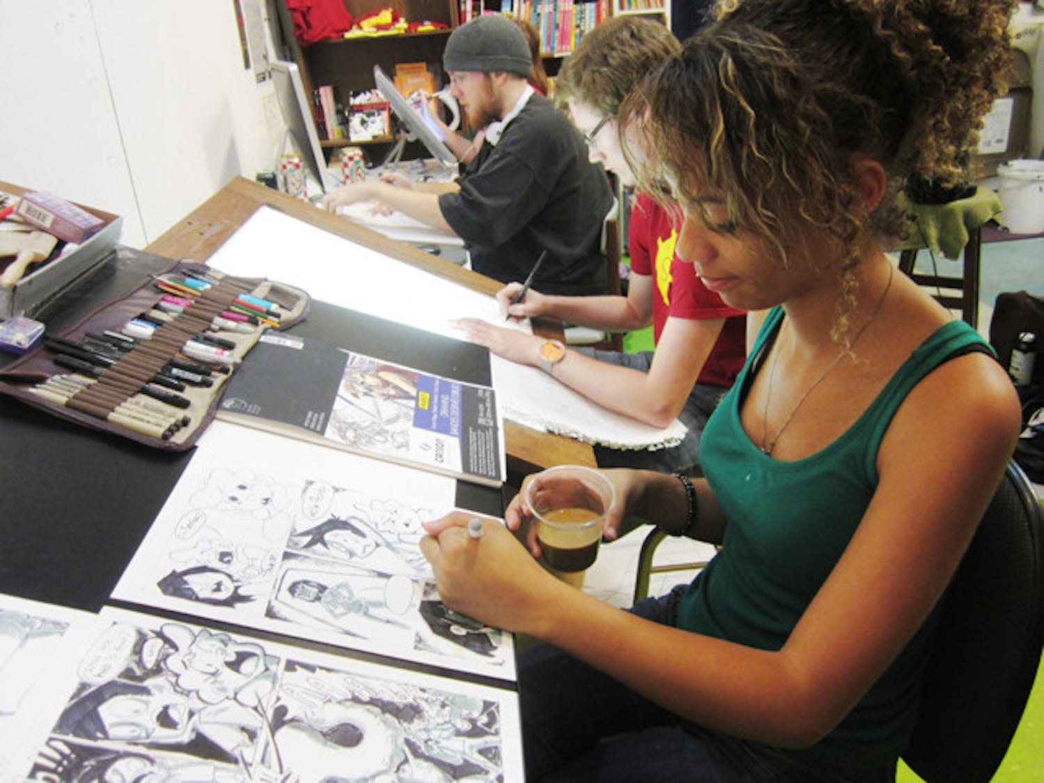 Kyana Mitchell, 18, works on her comic about children who discover a mutated squid monster in their basement. Mitchell participated in 24-Hour Comics Day Saturday and Sunday at the Sequential Artists Workshop downtown.