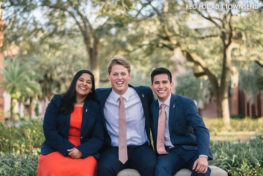<p>Impact Party's executive ticket consists of Michael Murphy, 21, for Student Body president (center); Sarah Abraham, 20, for Student Body vice president (left); and Santiago Gutierrez, 20, for Student Body treasurer (right).</p>