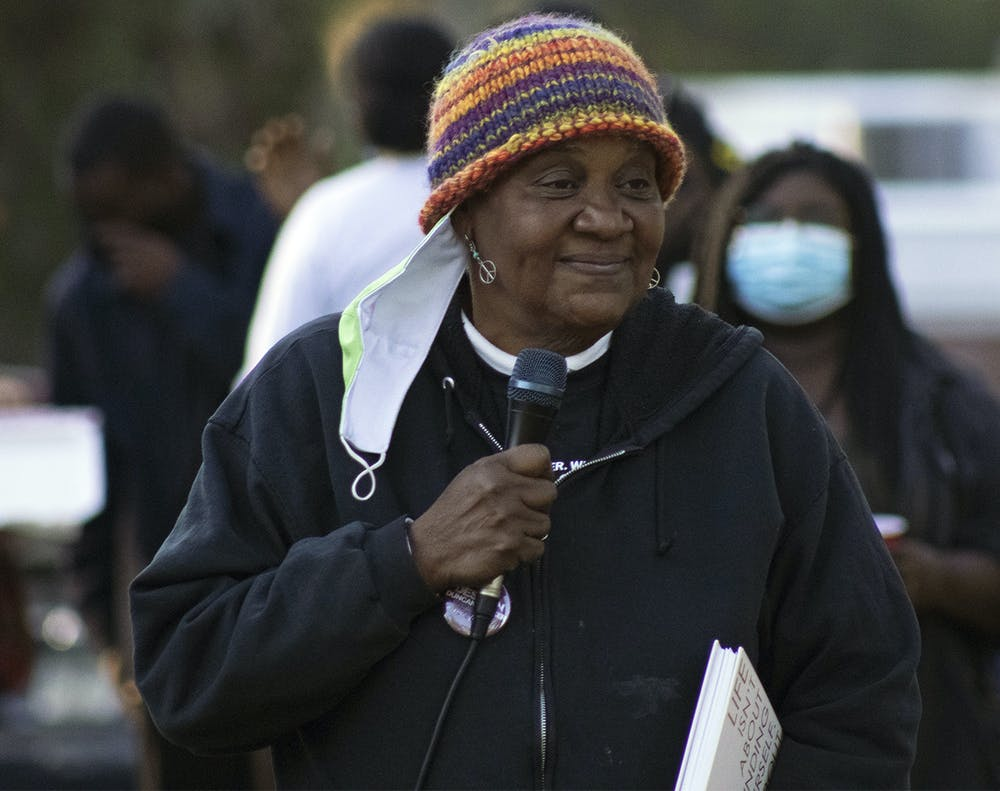 <p>Faye Williams, owner of M.A.M.A.'s Club, speaks at a community gathering organized by GoDDsville Dream Defenders on Friday, April 2, 2021. Williams spoke about an upcoming fundraiser for MAMA's Club and social issues affecting Gainesville.</p>