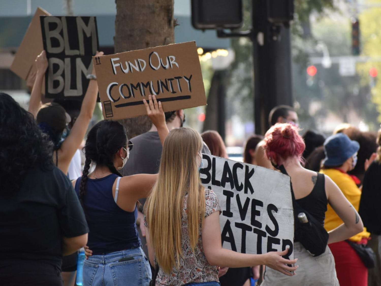 """Protesters faced University Avenue and chanted """"No justice, no peace. Defund the police."""" to Gainesville's evening traffic."""