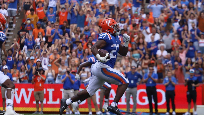 Florida's Dameon Pierce runs downfield away from Vanderbilt defenders during the Gators' 42-0 win on Oct. 9.